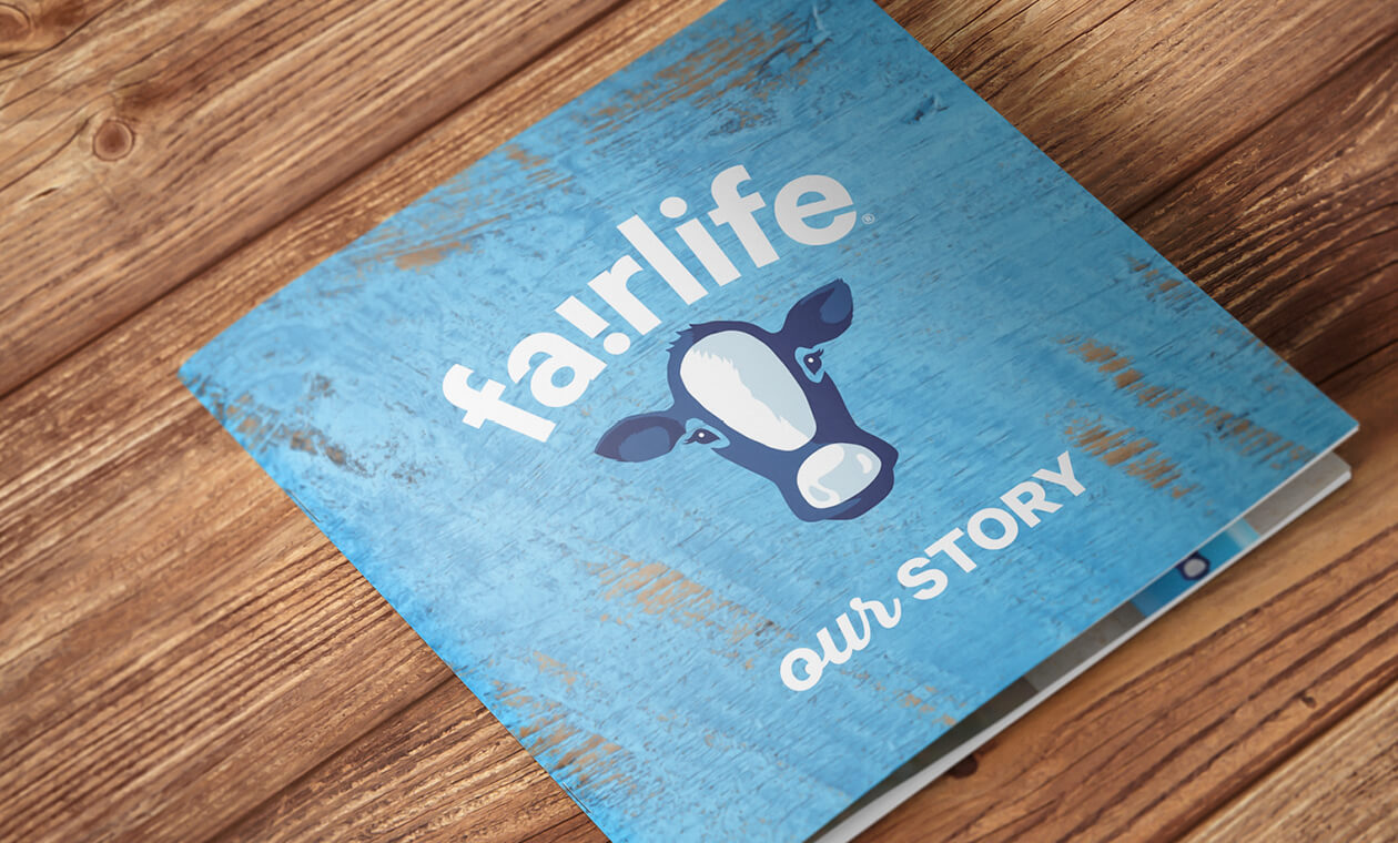 blue cover of a fairlife brochure on wood background